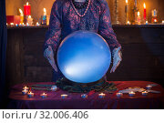 Hands of fortune teller with illuminated crystal ball. Стоковое фото, фотограф Майя Крученкова / Фотобанк Лори