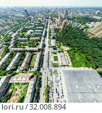 Купить «Aerial city view with crossroads and roads, houses, buildings, parks and parking lots. Sunny summer panoramic image», фото № 32008894, снято 21 января 2020 г. (c) Александр Маркин / Фотобанк Лори
