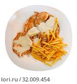 Top view of pork tenderloins with fried potatoes. Стоковое фото, фотограф Яков Филимонов / Фотобанк Лори