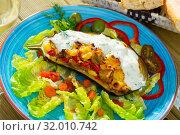 Купить «Delicious eggplant stuffed with vegetables and baked with cheese», фото № 32010742, снято 21 января 2020 г. (c) Яков Филимонов / Фотобанк Лори