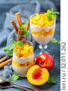 Rice pudding with nectarine, cinnamon and ginger. Стоковое фото, фотограф Марина Сапрунова / Фотобанк Лори