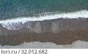 Купить «Aerial video of pebble beach natural background. Camera looks straight down.», видеоролик № 32012682, снято 14 июля 2019 г. (c) Serg Zastavkin / Фотобанк Лори
