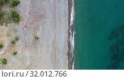 Купить «Aerial video of pebble sea beach natural background. Camera looks straight down.», видеоролик № 32012766, снято 14 июля 2019 г. (c) Serg Zastavkin / Фотобанк Лори