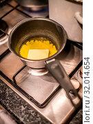 Купить «Butter Melting In Frying Pan in preparation for cake making», фото № 32014654, снято 6 августа 2020 г. (c) easy Fotostock / Фотобанк Лори