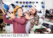 Купить «Father and son examining various roller-skates», фото № 32016370, снято 21 декабря 2016 г. (c) Яков Филимонов / Фотобанк Лори