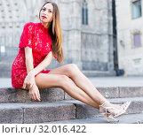 Купить «portrait of young adult girl in evening apparel sitting in european town», фото № 32016422, снято 24 июня 2017 г. (c) Яков Филимонов / Фотобанк Лори
