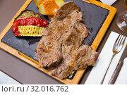 Купить «Beef steak with baked potatoes, vegetables, romesco», фото № 32016762, снято 19 сентября 2019 г. (c) Яков Филимонов / Фотобанк Лори