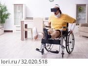Купить «Young man after accident recovering at home», фото № 32020518, снято 3 мая 2019 г. (c) Elnur / Фотобанк Лори