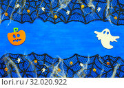 Купить «Halloween background withsSpider web, spiders and smiling jack and ghosts decorations as symbols of Halloween on the dark blue wooden background. Halloween concept.», фото № 32020922, снято 8 октября 2018 г. (c) Зезелина Марина / Фотобанк Лори