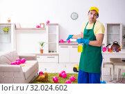 Купить «Young male contractor doing housework after party», фото № 32024602, снято 14 марта 2019 г. (c) Elnur / Фотобанк Лори