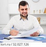 Купить «Smiling businessman is signing agreement papers», фото № 32027126, снято 5 марта 2017 г. (c) Яков Филимонов / Фотобанк Лори