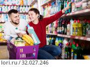 Купить «People buying detergents for house», фото № 32027246, снято 14 марта 2017 г. (c) Яков Филимонов / Фотобанк Лори