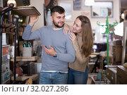 Купить «Couple looking for hallstand in shop», фото № 32027286, снято 9 ноября 2017 г. (c) Яков Филимонов / Фотобанк Лори
