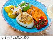 Купить «Photography of plate with sepia fried on a grill with pepper, boiled batat and honey-mustard sauce», фото № 32027350, снято 20 августа 2019 г. (c) Яков Филимонов / Фотобанк Лори
