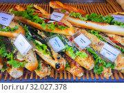 Купить «Tasty French sandwiches with cheese, tomato and olives on the counter», фото № 32027378, снято 10 октября 2018 г. (c) Яков Филимонов / Фотобанк Лори