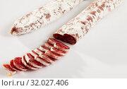 Купить «Sliced Catalan dry cured sausage Fuet», фото № 32027406, снято 5 августа 2020 г. (c) Яков Филимонов / Фотобанк Лори