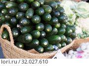 Купить «Fresh zucchini on market counter in wicker basket», фото № 32027610, снято 23 марта 2019 г. (c) Татьяна Яцевич / Фотобанк Лори