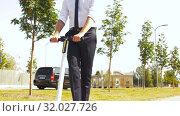 Купить «young businessman riding electric scooter outdoors», видеоролик № 32027726, снято 5 августа 2019 г. (c) Syda Productions / Фотобанк Лори