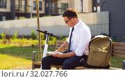 Купить «businessman writing to notepad and drinking coffee», видеоролик № 32027766, снято 5 августа 2019 г. (c) Syda Productions / Фотобанк Лори