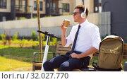 Купить «businessman with tablet pc, headphones and coffee», видеоролик № 32027770, снято 5 августа 2019 г. (c) Syda Productions / Фотобанк Лори