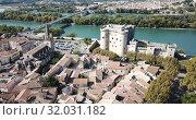 Купить «Aerial view of medieval fortified Chateau de Tarascon and Rhone river at sunny day», видеоролик № 32031182, снято 24 октября 2018 г. (c) Яков Филимонов / Фотобанк Лори