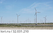 Купить «Wind Turbines at farmland in summer near the town of La Muela, Spain», видеоролик № 32031210, снято 29 июня 2019 г. (c) Яков Филимонов / Фотобанк Лори