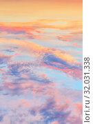 Купить «Heavenly abstract summer gentle vertical background. Beautiful picturesque bright majestic dramatic evening morning sky at sunset or dawn in orange and blue in pastel colors. The sun rises on a warm day», фото № 32031338, снято 28 июня 2019 г. (c) Светлана Евграфова / Фотобанк Лори