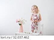 Купить «beautiful little blonde girls with flowers on white background», фото № 32037462, снято 15 августа 2019 г. (c) Майя Крученкова / Фотобанк Лори