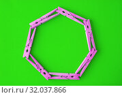 Купить «Round frame of colored wooden clothespins on a color bright yellow-green background. View from above. Copy space. Flat lay. The concept is natural, eco-friendly», фото № 32037866, снято 19 июня 2019 г. (c) Tetiana Chugunova / Фотобанк Лори