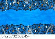 Купить «Halloween background with spider web, spiders and smiling jack and ghosts decorations as symbols of Halloween on the dark blue wooden background. Halloween holiday concept», фото № 32038454, снято 8 октября 2018 г. (c) Зезелина Марина / Фотобанк Лори