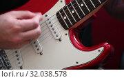 Close up man playing red electric guitar. Стоковое видео, видеограф Anton Eine / Фотобанк Лори