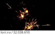 Close up several firework sparklers over black. Стоковое видео, видеограф Anton Eine / Фотобанк Лори