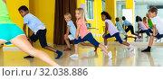 Купить «Active young children posing at dance class», фото № 32038886, снято 19 сентября 2019 г. (c) Яков Филимонов / Фотобанк Лори