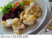Купить «Baked white fish with greens», фото № 32039226, снято 10 ноября 2018 г. (c) Яков Филимонов / Фотобанк Лори