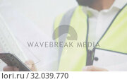 Купить «Architect calling on his phone», видеоролик № 32039770, снято 13 июня 2019 г. (c) Wavebreak Media / Фотобанк Лори