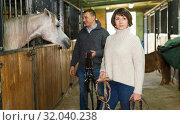Купить «Portrait of couple standing at stable», фото № 32040238, снято 26 ноября 2018 г. (c) Яков Филимонов / Фотобанк Лори