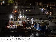 Autonomous landing of 57 Tunisian migrants at Lampedusa, southern Italy, 17 August 2019. Several patrol boats of the Italian finance guard and the harbor... Редакционное фото, фотограф Agf/Alessandro Serrano' / age Fotostock / Фотобанк Лори