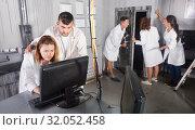 Купить «Adults trying to get out of escape room», фото № 32052458, снято 6 июля 2017 г. (c) Яков Филимонов / Фотобанк Лори