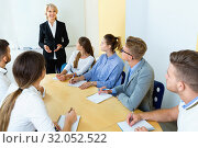 Купить «Female speaker giving presentation for students in lecture hall», фото № 32052522, снято 5 октября 2017 г. (c) Яков Филимонов / Фотобанк Лори