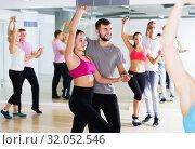 Купить «couples enjoying of partner dance», фото № 32052546, снято 9 октября 2017 г. (c) Яков Филимонов / Фотобанк Лори