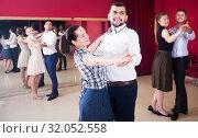 Купить «Young dancing couples enjoying foxtrot», фото № 32052558, снято 24 мая 2017 г. (c) Яков Филимонов / Фотобанк Лори