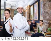 Smiling waitress with chef in the restaurant. Стоковое фото, фотограф Яков Филимонов / Фотобанк Лори