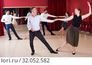Купить «Couples dancing boogie-woogie», фото № 32052582, снято 24 мая 2017 г. (c) Яков Филимонов / Фотобанк Лори