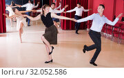 Купить «Dancing couples enjoying latin dances», фото № 32052586, снято 24 мая 2017 г. (c) Яков Филимонов / Фотобанк Лори