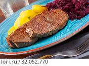 Купить «Veal steak with potato and sauerkraut», фото № 32052770, снято 19 сентября 2019 г. (c) Яков Филимонов / Фотобанк Лори