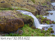 Small waterfall next to Urridafoss waterfall located in the Thjorsa River in southwest Iceland. Стоковое фото, фотограф Konrad Zelazowski / age Fotostock / Фотобанк Лори