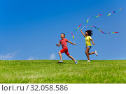 Купить «Boy and girl run with long color ribbons over sky», фото № 32058586, снято 15 июня 2019 г. (c) Сергей Новиков / Фотобанк Лори
