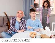 Купить «Woman scolding son and husband», фото № 32059422, снято 23 мая 2019 г. (c) Яков Филимонов / Фотобанк Лори