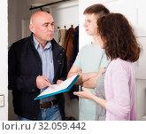 Купить «Family meeting with debt collector», фото № 32059442, снято 23 мая 2019 г. (c) Яков Филимонов / Фотобанк Лори