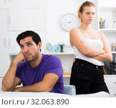 Купить «Guy at table after discord with girlfriend», фото № 32063890, снято 16 октября 2019 г. (c) Яков Филимонов / Фотобанк Лори